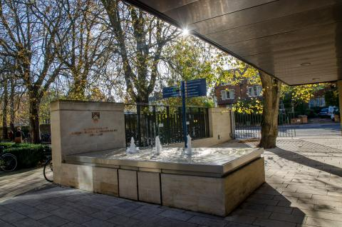 View of the college fountain outside the porters lodge facing the towards woodstock road from within the college