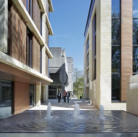Picture of the college entrance over the fountain looking onto the Hilda Besse Building between the gateway buildings
